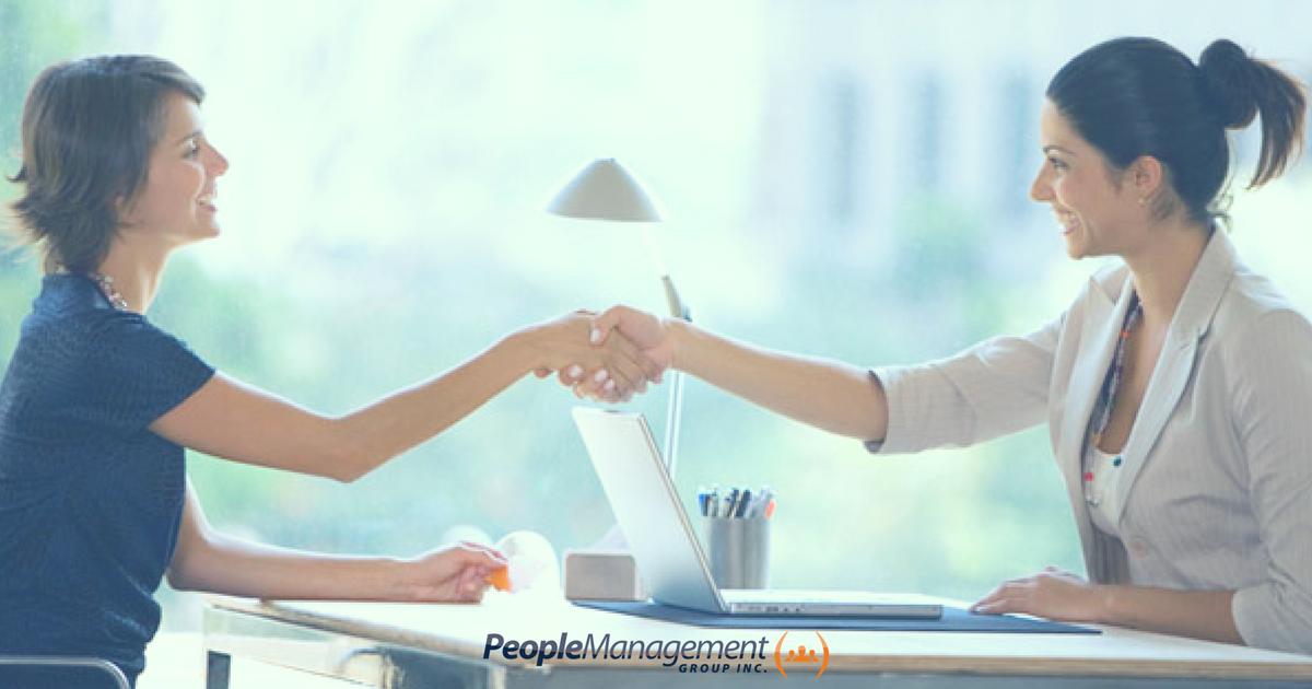 Corporate handshake across a desk