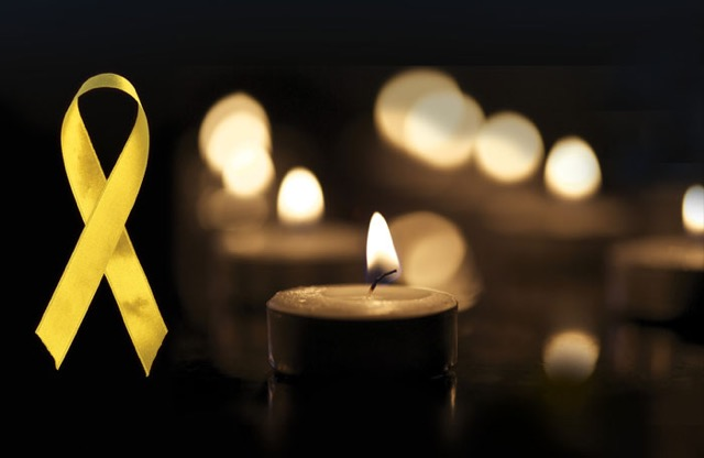 National Day of Mourning Candle and yellow Ribbon